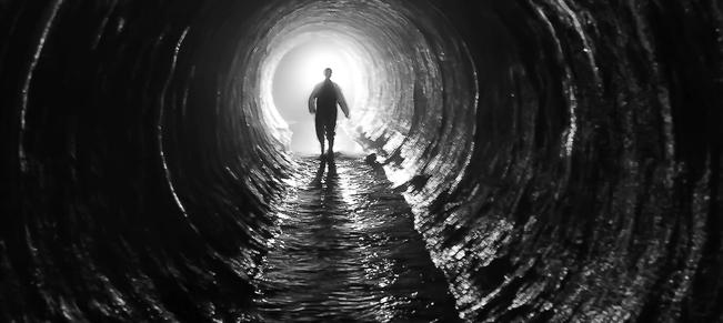 Man-Walking-Dark-Tunnel-Main_article_image